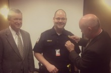 Chief Scott being badged by Kevin Vandeberg, Director of Operations at the POH