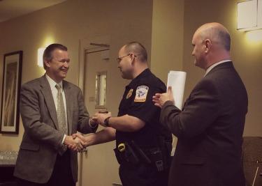 Chief Scott recieves badge from POH Exec. Dir. Rick Tucker